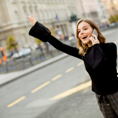 young-woman-waiting-taxi-bus-street-city_52137-66-2f8d8f6c